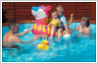 Add duck to photograph of family in swimming pool.