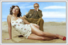 Remove beach ball from Woody Allen and Scarlett Johansson photo on the beach.
