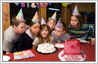 Add 'Happy Birthday' icing plate to birthday party photo