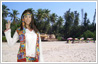 Photo editing to add a beach background to a girl's photo taken against a plain wall.